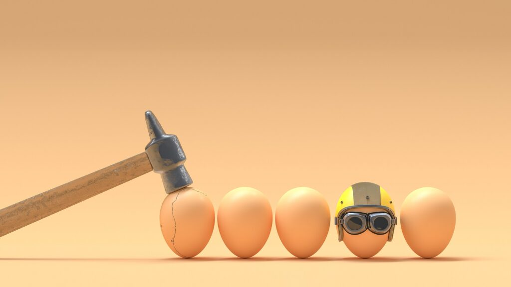 line up of brown eggs with hammer and helmet