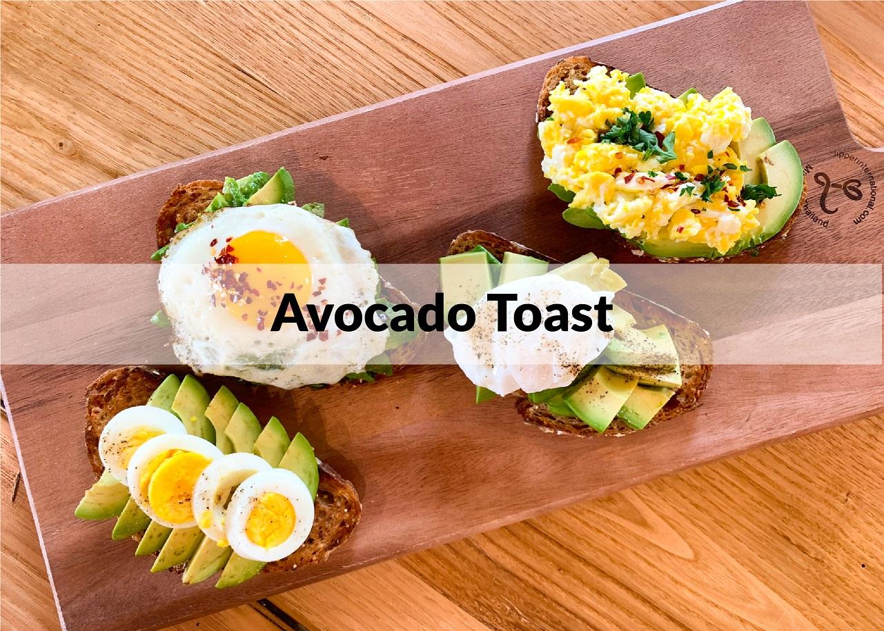 avocado toast 4-ways on a butcher board