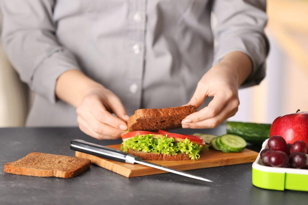 preparing breakfast sandwich on kitchen counter