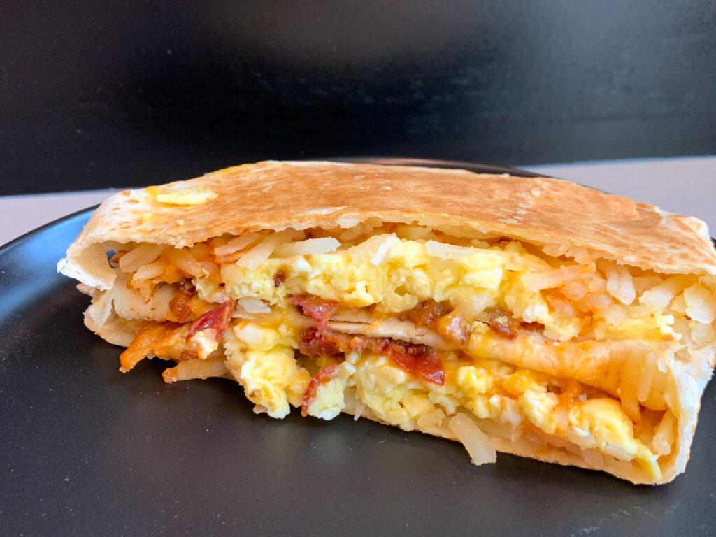 Taco Bell Breakfast Crunchwrap on black plate